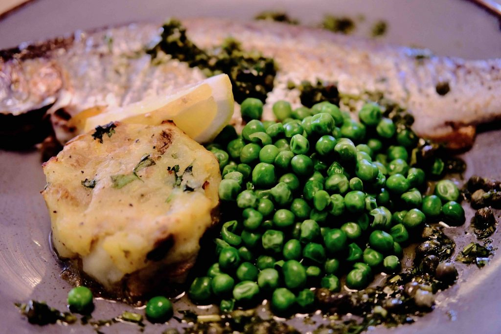 Roasted trout with new potatoes and peas