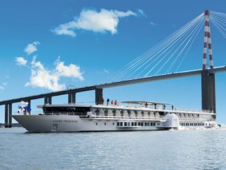 Loire Princesse sailing under Saint Nazaire Bridge