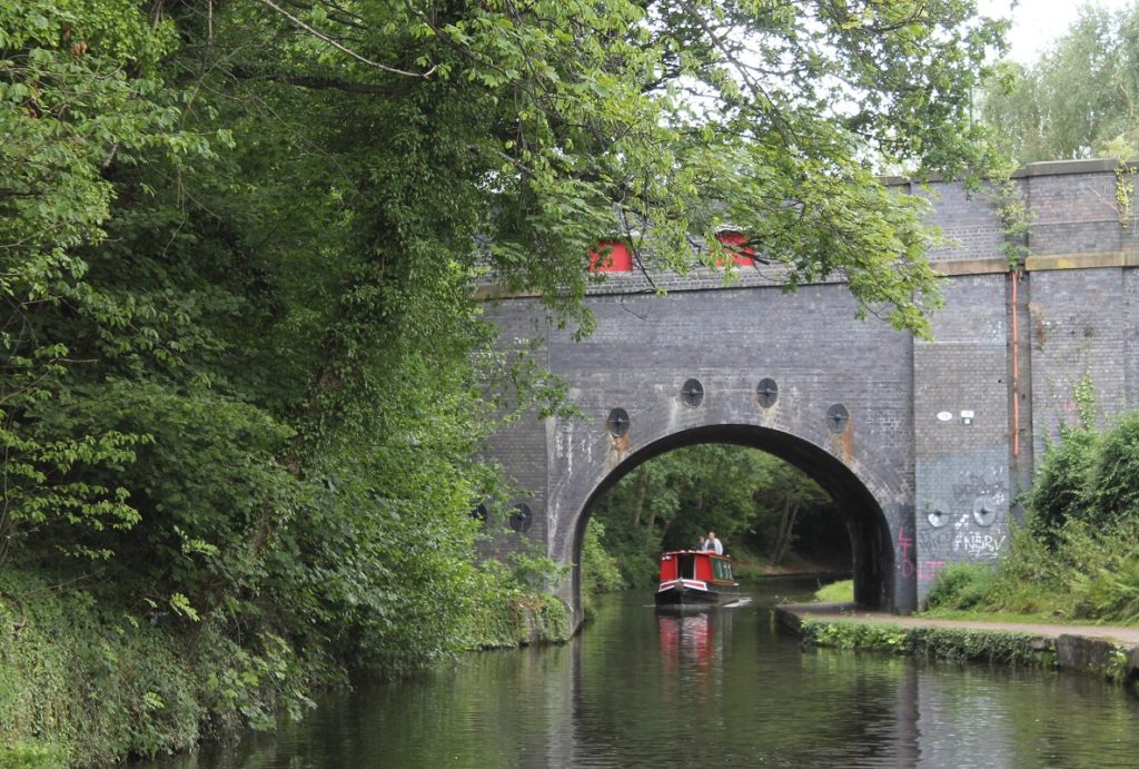 Narrowboat passing under bridge in Birmingham