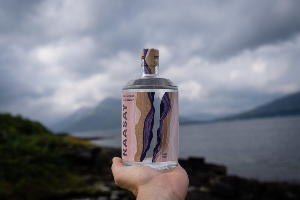 Holding bottle of Isle of Raasay Gin