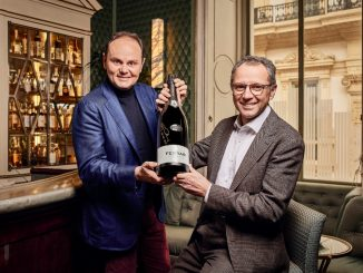 Matteo Lunelli and Stefano Domenicali with a bottle of Ferrari Trento
